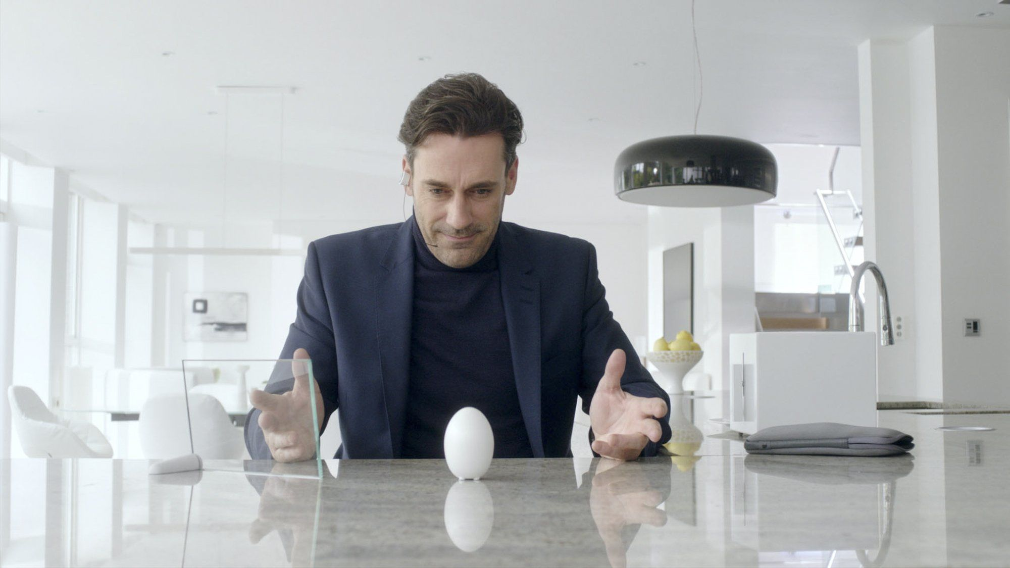 Man from Black Mirror's White Christmas episode, beholding an egg on a table